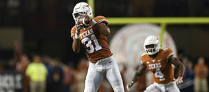 Texas linebacker Kyle Hrncir (31) intercepts a pass by Kansas quarterback Carter Stanley (9), not in the picture, during an NCAA football game, Saturday, Nov. 11, 2017 in Austin, Texas. (TFV Media via AP)
