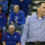 Kansas head coach Ray Bechard gives instruction to his players during the first set on Wednesday, Nov. 8, 2017.