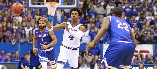 Kansas guard Devonte' Graham (4) dishes a pass to the corner during the second half on Friday, Nov. 10, 2017 at Allen Fieldhouse.