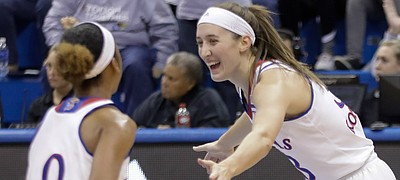 Kansas guard Kylee Kopatich (33) celebrates with a teammate after sinking one of her five first-half 3-point baskets in the Jayhawks' 66-48 win over Campbell on Sunday, Nov. 12 at Allen Fieldhouse.