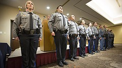 A line of graduating recruits stand before family members, friends and other officers during a graduation ceremony on Friday, Nov. 10, 2017 at the DoubleTree Hotel.