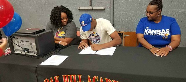 Class of 2018 big man David McCormack signs his national letter of intent to join the Kansas basketball program on Saturday, Nov. 11, 2017, at a ceremony with his family.