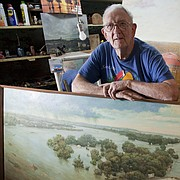 Paul Penny is pictured in his studio in the basement of his Old West Lawrence home in this 2013 file photo. Penny, a Lawrence artist, recently died at age 92.