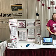 Free State High School junior Taylor Hamby, pictured here at last month's SHE Expo in Lawrence, recently launched Fe-Flow, a project that aims to provide local homeless and low-income women with reusable, washable sanitary pads. Hamby, who started the project as part of an extracurricular competition, says homeless women often lack access to basic feminine care products, which leads to infection and other health issues.