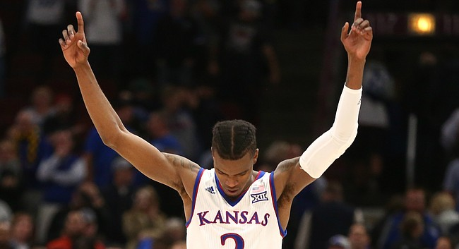 Kansas guard Lagerald Vick (2) raises his arms after the Jayhawks defeated the Wildcats 65-61 during the second half on Tuesday, Nov. 14, 2017 at United Center.