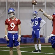 The Kansas football team practices inside Anschutz Pavilion, Monday, March 13, 2017. The practice was the first of the spring for the Jayhawks, including quarterbacks (from left) Carter Stanley, Peyton Bender and Tyriek Starks.