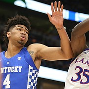 Kansas center Udoka Azubuike (35) fights for a rebound between Kentucky forward Nick Richards (4) and Kentucky forward Kevin Knox (5) during the first half on Tuesday, Nov. 14, 2017 at United Center.