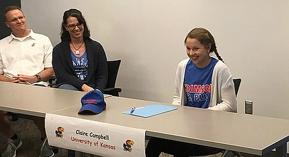 Free State senior Claire Campbell, right, laughs during her signing ceremony in the school's conference room Wednesday. Campbell signed to swim at Kansas.
