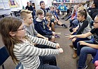 Southwest Middle School students and Haskell Indian Nations University students compete in an inter-tribal hand game during Share Southwest activities at Southwest Middle School Wednesday, Nov. 15. The event was a collaboration between Haskell students and the SWMS Native Club.