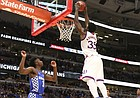 Kansas center Udoka Azubuike (35) gets up for a lob jam against Kentucky during the second half on Tuesday, Nov. 14, 2017 at United Center.