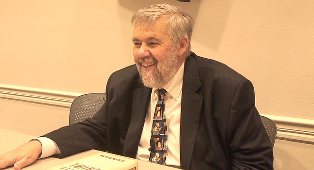 "In this file photo from May 2011, Bill James chats about his book ""Popular Crime"" at the Lawrence Public Library."