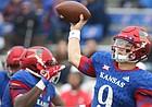 Kansas quarterback Carter Stanley (9) throws a pass during the third quarter that was intercepted, Saturday, Sept. 4, 2017 at Memorial Stadium.