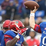Kansas quarterback Carter Stanley (9) throws a pass during the third quarter that was intercepted, Saturday, Sept. 4, 2017 at Memorial Stadium.