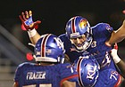 Kansas tight end Ben Johnson (84) is hoisted up by Kansas offensive lineman Hakeem Adeniji (78) after Johnson's touchdown during the third quarter on Saturday, Sept. 2, 2017 at Memorial Stadium.