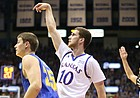Kansas guard Sviatoslav Mykhailiuk (10) watches his shot behind South Dakota State guard Lane Severyn (25) during the first half on Friday, Nov. 17, 2017 at Allen Fieldhouse.
