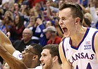 Kansas forward Mitch Lightfoot (44) and the Jayhawks' bench react to a three from Kansas guard Chris Teahan (12) during the second half on Friday, Nov. 17, 2017 at Allen Fieldhouse.