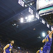 Kansas guard Sviatoslav Mykhailiuk (10) puts up a three from the corner over South Dakota State forward Mike Daum (24) with seconds remaining in the first half on Friday, Nov. 17, 2017 at Allen Fieldhouse.