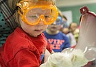 In this 2015 file photo, Raiden Gallagher, 3, of Topeka, holds out a hand to receive a bubble created from dry ice and soapy water during the 20th annual Carnival of Chemistry. The carnival returns on Sunday, Nov. 19.