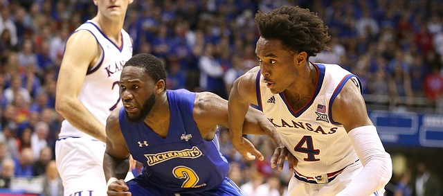 Kansas guard Devonte' Graham (4) drives to the bucket past South Dakota State guard Tevin King (2) during the first half on Friday, Nov. 17, 2017 at Allen Fieldhouse.