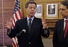 In this AP file photo from Sept. 11, 2014, Kansas Gov. Sam Brownback, left, and Lt. Gov. Jeff Colyer speak at the Statehouse in Topeka.
