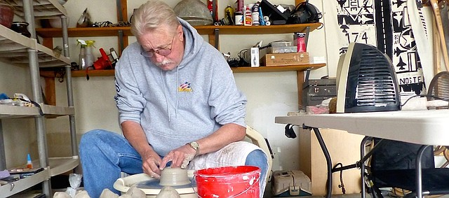 Chuck Watson throws a vase Saturday on a pottery wheel in his west Lawrence garage. The retired high school art teacher will be one of 106 vendors offering handmade crafts or homemade goodies Sunday at the Holiday Bazaar at the Community Building, 115 W. 11th St.
