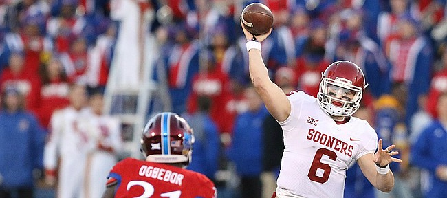 Oklahoma quarterback Baker Mayfield (6) throws over Kansas linebacker Osaze Ogbebor (31) during the third quarter on Saturday, Nov. 18, 2017 at Memorial Stadium.