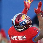 Kansas defensive end Dorance Armstrong Jr. (2), Kansas defensive tackle Daniel Wise (96) and Kansas linebacker Osaze Ogbebor (31) celebrate after Armstrong sacked Oklahoma quarterback Baker Mayfield (6) during the third quarter on Saturday, Nov. 18, 2017 at Memorial Stadium.