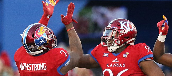 Kansas defensive end Dorance Armstrong Jr. (2), Kansas defensive tackle Daniel Wise (96) and Kansas linebacker Osaze Ogbebor (31) celebrate after Armstrong sacked Oklahoma quarterback Baker Mayfield (6) during the third quarter on Saturday, Nov. 18, 2017 at Memorial Stadium.