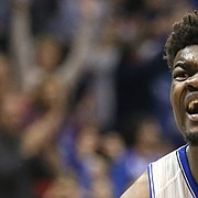 Kansas center Udoka Azubuike (35) disputes a technical foul called against him for hanging on the rim following a dunk during the first half, Tuesday, Nov. 21, 2017 at Allen Fieldhouse.