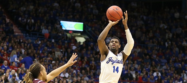 Kansas guard Malik Newman (14) puts up a three over Texas Southern forward Kevin Scott (4) during the second half, Tuesday, Nov. 21, 2017 at Allen Fieldhouse.