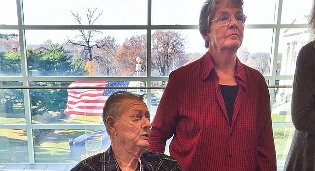 Harold Leach, left, and Alberta Leach, center, parents of Randy Leach, who was 17 when he disappeared in April 1988, talked to supporters outside Leavenworth County District Court on Tuesday, Nov. 21, 2017, in Leavenworth, Kan. The parents are seeking a court order to open records in the investigation of their son's unsolved death. (Steve Fry/The Capital-Journal via AP)