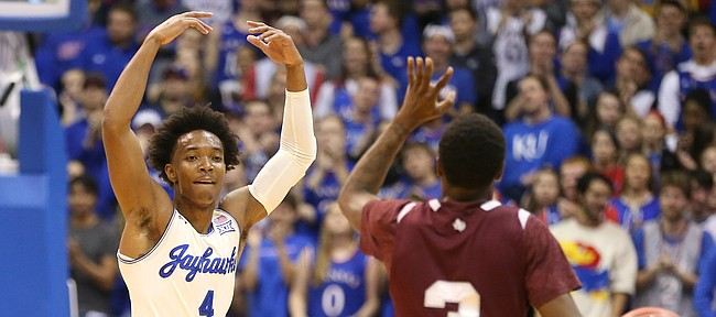 Kansas guard Devonte' Graham (4) raises up the Fieldhouse after a string of buckets during the first half, Tuesday, Nov. 21, 2017.