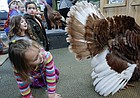 Four-year-old Amelia Meyer, Lawrence, tries to draw the attention of Tom the turkey during Turkey Time Tuesday, Nov. 21, at Prairie Park Nature Center, 2730 Harper St.