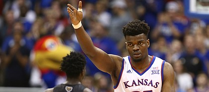 Kansas center Udoka Azubuike (35) signals the ball going the Jayhawks' direction after an Oakland turnover during the first half on Friday, Nov. 24, 2017 at Allen Fieldhouse.