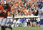 Kansas defensive end Dorance Armstrong Jr., right, chases after Oklahoma State quarterback Mason Rudolph as he scores a touchdown in the first half of an NCAA college football game between Kansas and Oklahoma St in Stillwater, Okla., Saturday, Nov. 25, 2017.