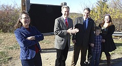 Gov. Sam Brownback and his wife, Mary, dedicate the trail system adjacent to Cedar Crest in honor of Ken Smith, at right, the chief maintenance officer at the governor's mansion and the person primarily responsible for developing the trails.