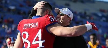 Kansas head coach David Beaty gives a hug to senior tight end Ben Johnson during the Senior Day ceremony on Saturday, Nov. 18, 2017 at Memorial Stadium.
