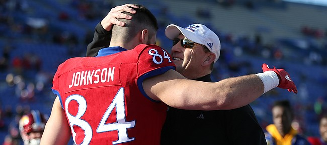 Kansas head coach David Beaty gives a hug to senior tight end Ben Johnson during the Senior Day ceremony on Saturday, Nov. 18, 2017 at Memorial Stadium.