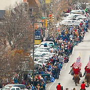 Spectators line the street as the the Old Fashioned Christmas Parade heads south on Massachusetts Street on Saturday, Dec. 3, 2016 in downtown Lawrence.