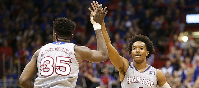 Kansas guard Devonte' Graham (4) high fives Kansas center Udoka Azubuike (35) after feeding him a pass for a dunk during the second half on Tuesday, Nov. 28, 2017 at Allen Fieldhouse. Graham finished with a career-high, 35 points.