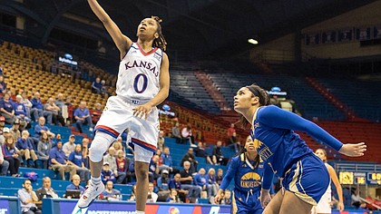 Junior Kansas guard Christalah Lyons scores on a layup Wednesday, Nov. 29, 2017, during a game against UMKC at Allen Fieldhouse. The Jayhawks won, 63-48.