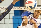 Kansas senior middle blocker Taylor Alexander drills a spike against West Virginia on Saturday, Nov. 25, 2017 at Horejsi Family Athletics Center.