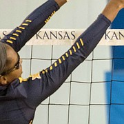Kansas senior middle blocker Taylor Alexander drills a spike against West Virginia on Saturday, Nov. 25, 2017 at Horejsi Family Athletics Center.