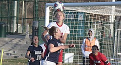 Lawrence High alumna and Central Missouri freshman Skylar Drum rises up for a header while defending a corner kick in the Jennies' 3-0 win over Mercy College (N.Y.) in the NCAA Division II national semifinals on Thursday at Swope Soccer Village.