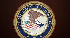 The U.S. Department of Justice logo is seen on a podium following a news conference in the office of the U.S. Attorney for the District of Maryland in Baltimore, Wednesday, March 1, 2017. (AP Photo/Patrick Semansky)