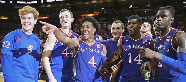 Kansas guard Devonte' Graham (4) holds the MVP trophy as he and the Jayhawks acknowledge the KU fans following their 76-60 win over Syracuse, Saturday, Dec. 2, 2017 at American Airlines Arena in Miami.