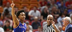 Kansas guard Devonte' Graham (4) signals the ball going the Jayhawks direction after forcing a Syracuse turnover during the second half, Saturday, Dec. 2, 2017 at American Airlines Arena in Miami.