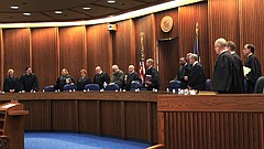 In this AP file photo from Dec. 9, 2015, the 14 members of the Kansas Court of Appeals enter the Supreme Court courtroom in Topeka to hear oral arguments.