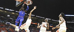 Kansas guard Lagerald Vick (2) delivers on a lob jam over Syracuse forward Matthew Moyer (2) during the first half, Saturday, Dec. 2, 2017 at American Airlines Arena in Miami.