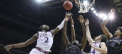 Kansas guard Lagerald Vick (2) and Kansas forward Mitch Lightfoot (44) fight for a rebound with Washington forward Noah Dickerson (15) and Washington guard Matisse Thybulle (4) during the second half, Wednesday, Dec. 6, 2017 at Sprint Center.